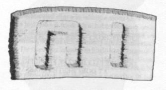 Letter-like shapes found <em>inside</em>; a block of marble.